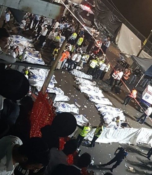 Bodies are laid out at the scene of the disaster