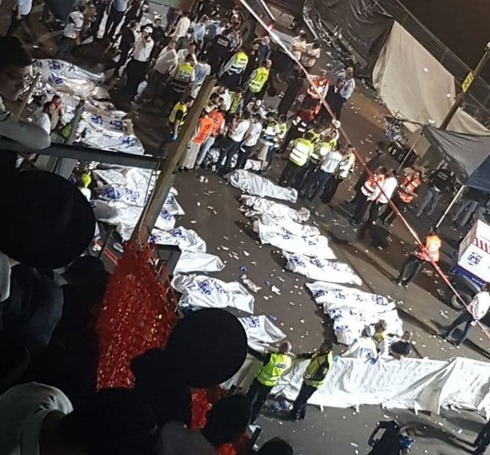 The bodies of the victims of the Meron disaster are lined up at the site