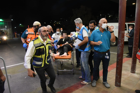 First responders evacuate a reveler hurt in the Mount Meron stampede to Ziv Medical Center in Safed