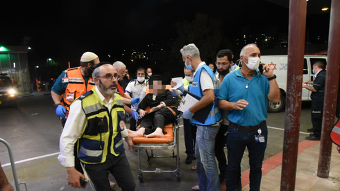 An injured man arrives at the Ziv Medical Center in Safed from the disaster at Mount Meron early on Friday