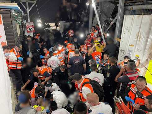 Rescue workers from the United Hatzalah volunteer service trying to treat the injured during the Meron disaster