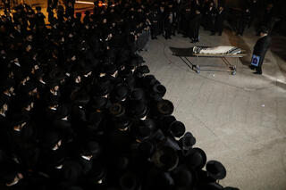 The funeral for Menachem Kenlowitz, 22, is held in Jerusalem on Saturday night