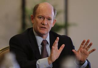 Senator Chris Coons of Delaware talks to the journalists during a press briefing in Abu Dhabi, United Arab Emirates