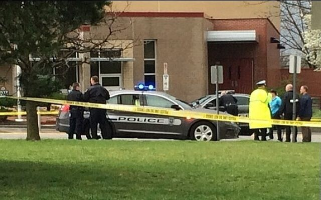 authorities respond to the Jewish community center after a shooting in Overland Park, Kan.