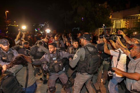 Israeli security forces detain a Palestinian amid ongoing confrontations as Palestinian families face eviction in the Sheikh Jarrah neighborhood