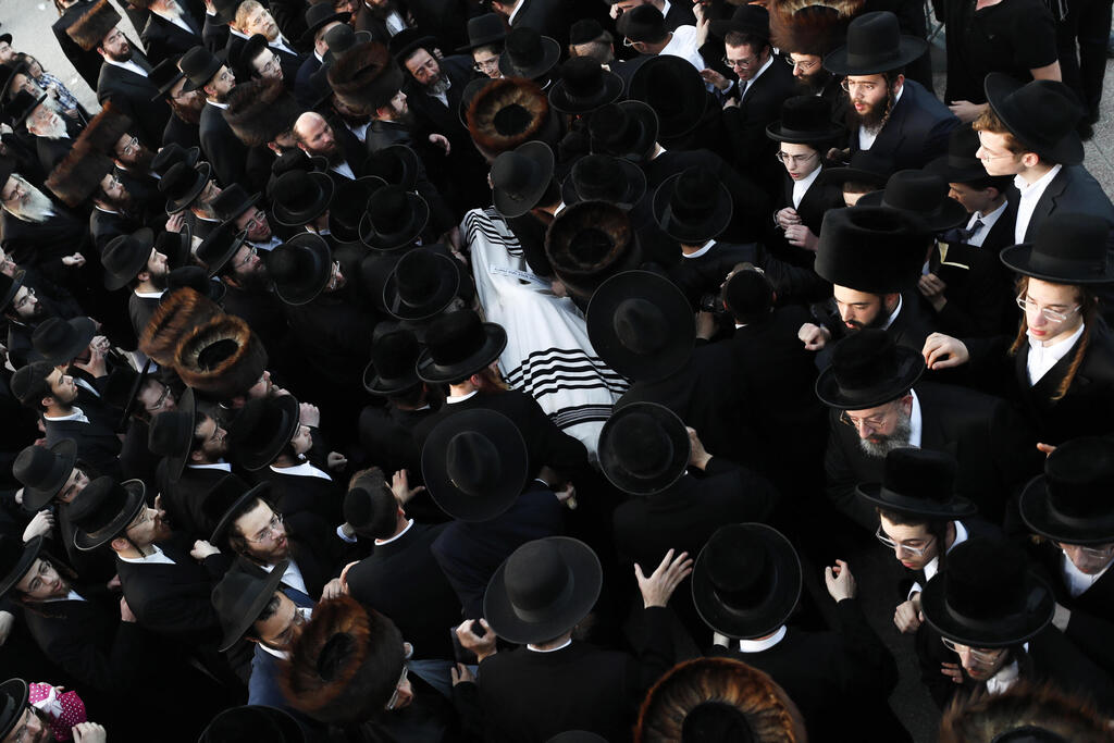 Ultra-Orthodox mourners attend the funeral in Jerusalem for one of the victims of the crush at Mount Meron, April 30, 2021