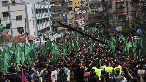 Hamas supporters wave green Islamic flags during a rally in solidarity with fellow Palestinians in Jerusalem