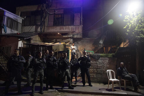 Israeli police stand guard in front of a Palestinian home occupied by settlers during a protest on the eve of a court verdict that may forcibly evict Palestinian families from their homes in the Sheikh Jarrah neighborhood of Jerusalem