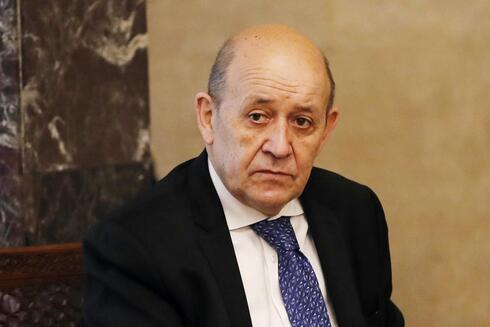 French Foreign Minister Jean-Yves Le Drian, looks on as he meets with Lebanese President Michel Aoun at the Presidential Palace in Baabda, east of Beirut, Lebanon