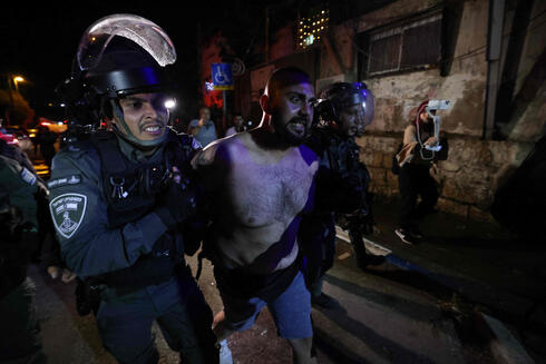 A Palestinian protester is arrested from in front of an Israeli settler's house during a demonstration as Palestinian families face eviction, part of an ongoing effort by Jewish Israelis to take control of homes in the Sheikh Jarrah neighbourhood of occupied east Jerusalem