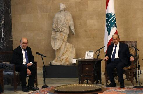 French Foreign Minister Jean-Yves Le Drian, left, meets with Lebanese President Michel Aoun at the Presidential Palace in Baabda, east of Beirut, Lebanon