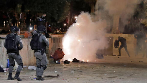 Palestinian protesters clash with police at the al Aqsa mosque compound in Jerusalem last month