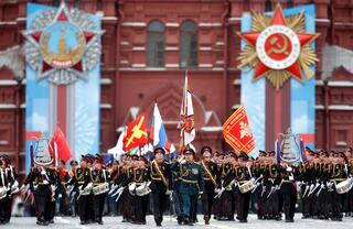 Russian service members and cadets march during a military parade on Victory Day, which marks the 76th anniversary of the victory over Nazi Germany in World War Two, at the Red Square in central Moscow
