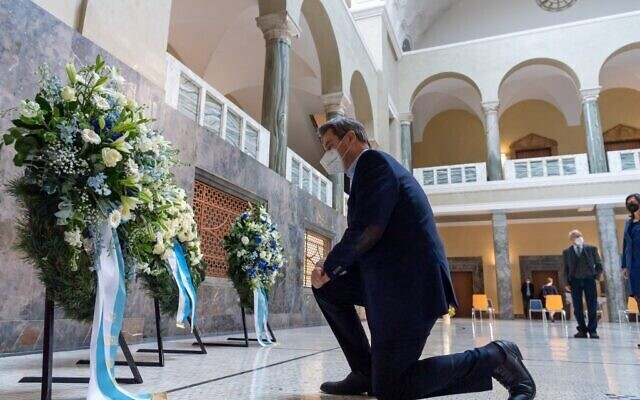 Bavaria's State Prime Minister Markus Soeder lays a wreath of flowers during a commemoration on the occasion of the 100th birthday of anti-Fascist Sophie Scholl, who was killed by the Nazi regime in 1943, in the staircase of Ludwig Maximilian University in Munich