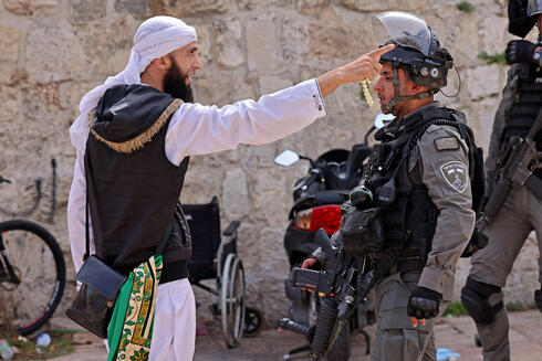 A Palestinian argues with a Border Police officer in the Old City of Jerusalem, May 10, 2021