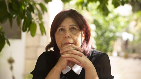 Samira Dajani pauses during an interview at her home, where she has lived since childhood, in the Sheikh Jarrah neighborhood of east Jerusalem