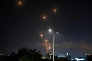 The Iron Dome missile defense system intercepts rockets over Ashkelon on Monday night