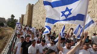 Young religious Israelis attending the 'Flag parade' in Jerusalem on May 10, which was cut short due to a barrage of rockets from Gaza