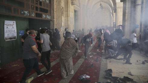 Palestinians clash with Israeli security forces at the al-Aqsa Mosque compound in Jerusalem's Old City, May 10, 2021