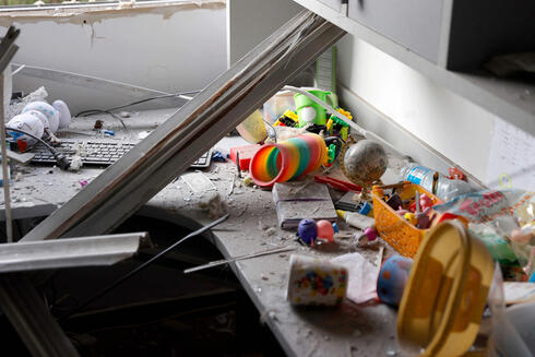 A picture taken early Tuesday shows damage to a bedroom hit by a rocket in Ashkelon