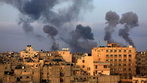 Smoke rises after an IDF strike on Gaza following rocket fire from the Strip at Israeli communities on Tuesday