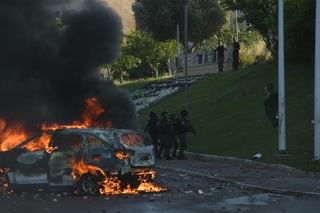 Vehicle torched by rioters in Lod