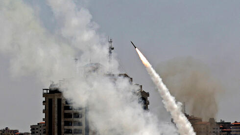 A rocket launched from Gaza city towards Israel during May cross border fighting