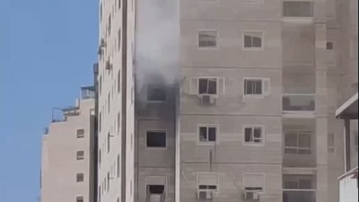 A residential building where one of the victims lived suffers a direct hit