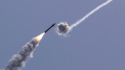 The Iron Dome missile defense system intercepts a rocket from Gaza