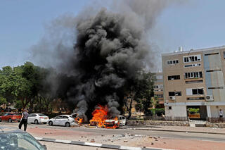 A rocket fired from Gaza hits a target in the southern city of Ashkelon on Tuesday