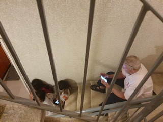 Civilians take cover in a stairwell in a Tel Aviv building during a rocket attack