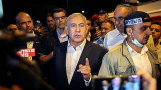 Prime Minister Benjamin Netanyahu in Lod late on Tuesday