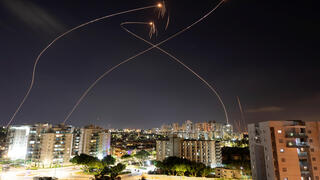 The Iron Dome missile defense systems intercepts rockets fired from Gaza over Ashkelon in May 2021