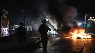 Police forces in Lod during rioting earlier this month