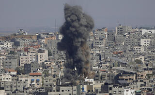 Smoke rises following Israeli airstrikes in Gaza during the May 2021 conflict