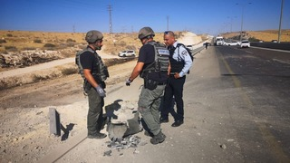 Security forces at teh scene of a rocket strike in the southern city of Be'er Sheva on Friday