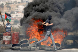 Clashes between Palestinian rioters and IDF troops in the West Bank city of Jenin