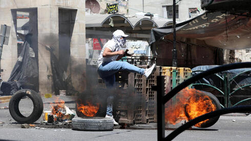 Palestinians demonstrate in the West Bank on Friday