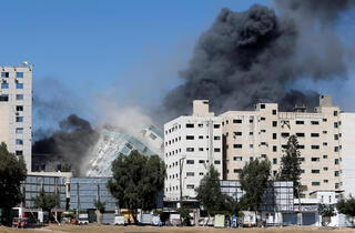 The IDF brings down a high-rise building in Gaza that it said was a Hamas intelligence site as well as offices for foreign media