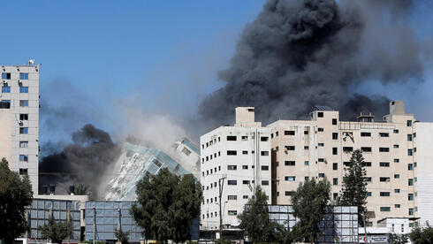 Gaza building that houses foreign media and civilians destroyed in IDF strike