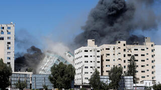The Gaza building that houses foreign media and civilians destroyed in IDF strike