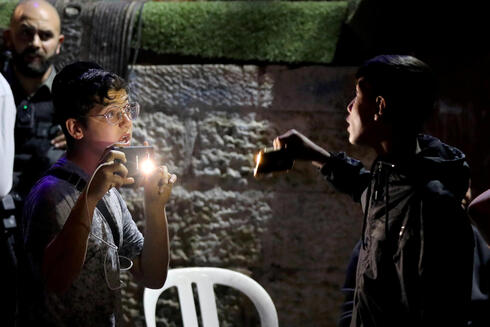 A Jew and a Palestinian confront each other with their mobile phones amid ongoing tension ahead of an upcoming court hearing in an Israel-Palestinian land-ownership dispute in the Sheikh Jarrah neighborhood of East Jerusalem May 5, 2021