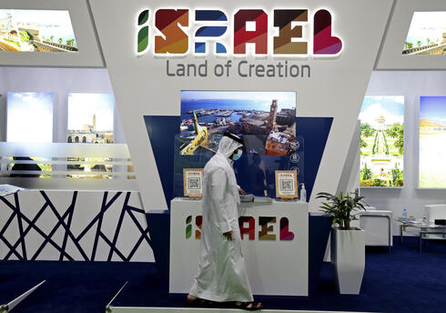 A man passes by the Israel stand on the opening day of the Arabian Travel Market exhibition, in Dubai, United Arab Emirates, Sunday, May 16, 2021