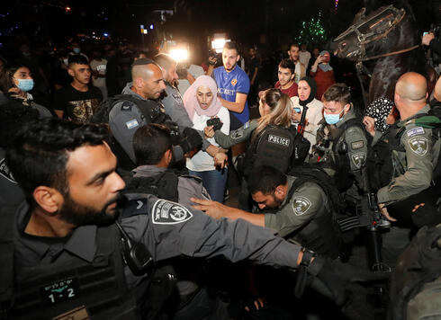 A Palestinian resident reacts during scuffles with Israeli police amid ongoing tension ahead of an upcoming court hearing in an Israeli-Palestinian land-ownership dispute in the Sheikh Jarrah neighborhood of East Jerusalem May 4, 2021
