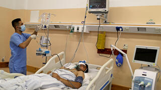 A wounded Palestinian man lies on a bed in Shifa hospital in Gaza