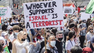 People in Montreal attend a demonstration on Saturday, May 15, 2021, to protest Israel's military actions in Gaza