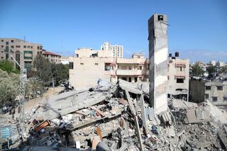A view shows the remains of a building after it was destroyed in Israeli air strikes, amid a flare-up of Israeli-Palestinian fighting, in Gaza City