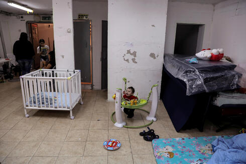 Israelis stay inside a bomb shelter as Israeli-Palestinian cross-border violence continues, in Ashkelon, southern Israel