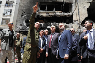 Foreign Minister Gabi Ashkenazi and his German, Czech and Slovak counterparts visit a building in the central city of Petah Tikvah that took a direct hit from a rocket fired from the Gaza Strip, May 20, 2021