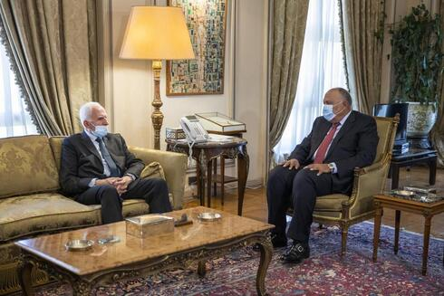 Egyptian Foreign Minister Sameh Shoukry, right, meets with Palestinian Fatah official Azzam Al-Ahmad at the foreign ministry in Cairo